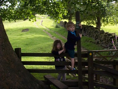 Picture of children crossing a style at Wycoller - click the picture for more of the beauty of Pendle in Pictures.